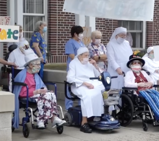 The Little Sisters of the Poor's parade celebrates the birthdays of two residents in their 100s
