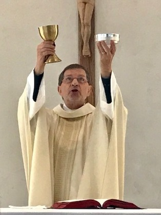 Holy Cross Father Frank Zlotkowski  celebrates Mass in a hospital chapel. He is a chaplain for the Seton Healthcare Family of Hospitals in Austin. (Photo by Ricardo Gandara)