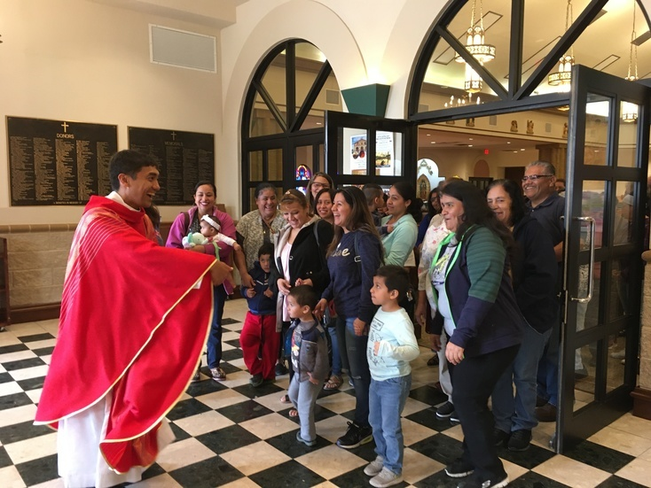 Missionaries of Faith Father Benjie Magnaye, pastor of Sacred Heart Parish in Waco, greets parishioners after Mass. (Photo courtesy Sacred Heart Parish)