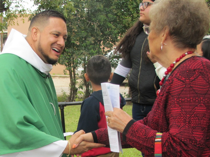 Father Javier Toscano, pastor of St. Mary Parish in San Saba, greets  parishioners after Mass. The small, yet faithful, rural parish recently came together to complete a multi-use facility on the parish grounds. (Photo by Alfredo E. Cardenas)