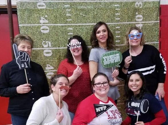Mrs. Luparell and a few of her 3rd grade moms having fun at the auction