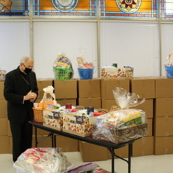 Archbishop Aymond Blesses Catholic Charities Thanksgiving Baskets