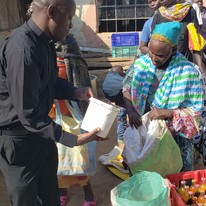 fr james distributing food