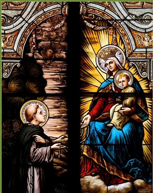 Stained glass window of St. Dominic and the Virgin Mary