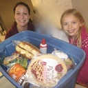 Carondelet students deliver Thanksgiving Baskets to Waite House Families