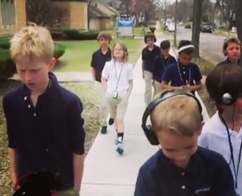 "Students walking, listening, and learning with Carondelet's new ""Walking Classroom"""
