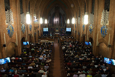 A view of the sold out nave of Our Lady of Refuge Church in Brooklyn the night of dedication of the pipe organ