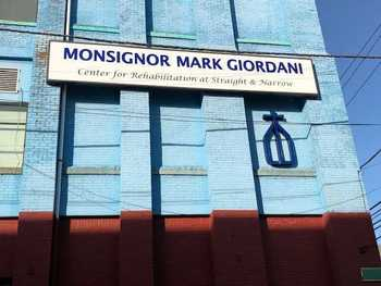 The Monsignor Mark Giordani Center Receives a New Sign