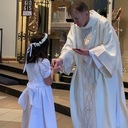 Josephine Reed Makes Her First Communion