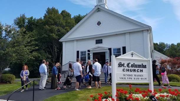 People gathering in front of St. Columba Church