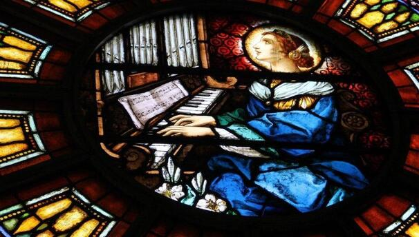 St. Cecilia at the center of the rose window of Sacred Heart Church (Eau Claire, WI)