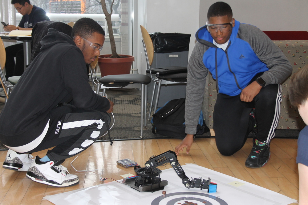 students practicing robotics