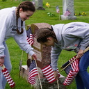 Holy Name students place flags on veterans' graves