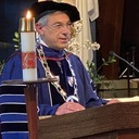 Assumption College president confers degrees