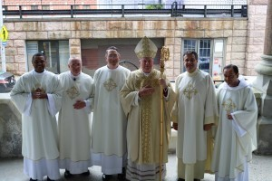 Bishop McManus poses with the newly ordained outside St. Paul Cathedral.