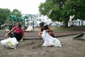 Girls cleanup Crompton Park in the Green Island neighborhood of Worcester in 2010 file photo