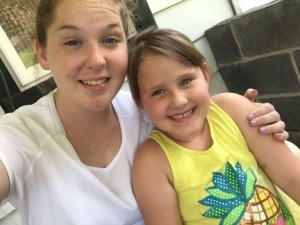"Volunteer Emily Whamond with 6-year-old Kailey: ""I truly felt as though I was doing God's work, both in helping this family in making a safer home, but also by developing a friendship with Kailey."""