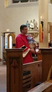 Deacon Covino holds his grandson Calvin.