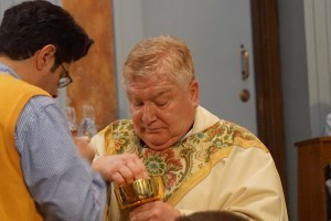 Domenic Mercurio is the last parishioner to receive Communion.