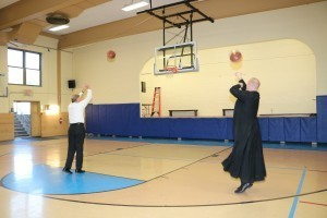 Bishop McManus and Father Slavinskas shoot hoops.