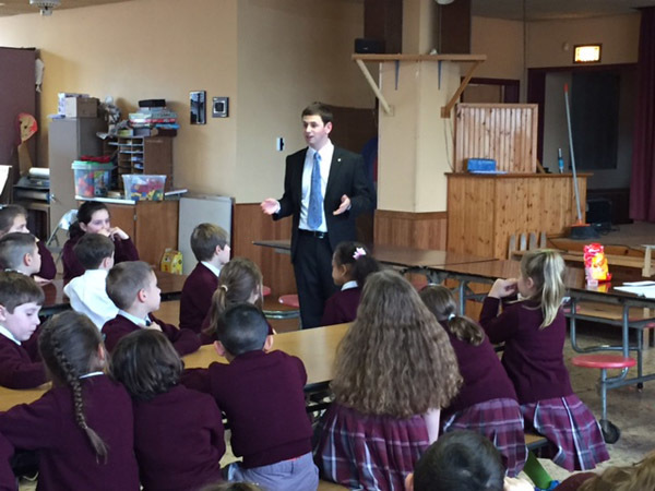 Photo courtesy of Bethany Terho FITCHBURG – Ryan Sarasin, a graduate of St. Anthony Elementary School, talks to students here Monday about his priestly vocation. He is  studying at St. Anselm College.