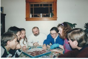 In this photo from the 1990s John Medbury and his wife, Linda Cavioli, play a game with his children and the children Catholic Charities helped them adopt.