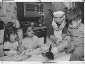 This 1967 photo shows on of the Little Sisters of the Assumption tending to a little boy in his home.
