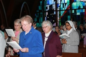 Religious participate in the Mass for the Year of Consecrated Life Saturday at Assumption College. In foreground, from left, are Sister Michele Jacques, a Sister of St. Anne; Sister Pauline Leblanc, a Sister of the Presentation of the Blessed Virgin Mary; Sister Janet Provost, a Sister of St. Joseph, and Sister Roslin Cyriac, a Venerini Sister. Photo by Tanya Connor