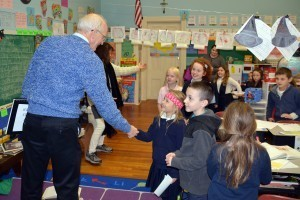 Charles McQuiad visits the classrooms.