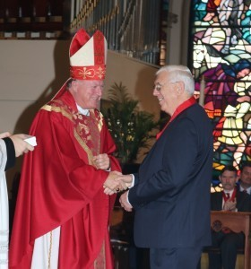 Bishop McManus gives The Distinguished Catholic Lay Person Award to  John J. Monahan of the Monahan Group of Worcester.
