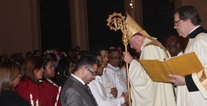 Bishop greets Ranfy Rodriguez at Easter Vigil. Photo by Tanya Connor