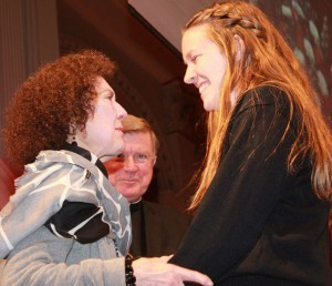Beth McManus and Brittany Gibbons greet each other before the St. Bernard's junior receives the Charles & Beth McManus Award for Academic Excellence. Bishop McManus smiles in the background.  Photo by Tanya Connor