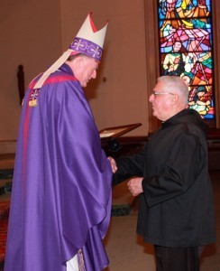 Father Lamothe receives his award from Bishop McManus. Photo by Tanya O'Connor