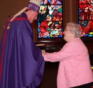 Sr. Paula Kelleher receives award from Bishop McManus. Photo by Tanya Connor