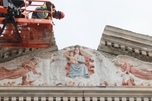 Photos by Tanya Connor On Thursday morning, Feb. 4, workers dismantle the facade of Mount Carmel Church taking down the cap stone over Our Lady.