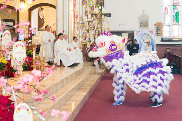 Lions doing the lion dance first bow to the altar, to show respect for God, and to the bishop, to show respect for him.  Photo by Tan Du