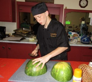 Seth Apher, a culinary student at Tantasqua Regional High School in Sturbridge, hones his skills at Fellowship Meal program.