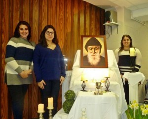 From left to right, Tala Khoury, Louisa Tannous and Aya Khoury helped to lead the rosary for the congregation in front of the relics of St. Charbel. Photo by Susan Bailey