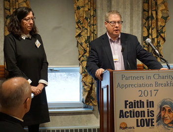Priests' retirement fund gets gift at Partners breakfast