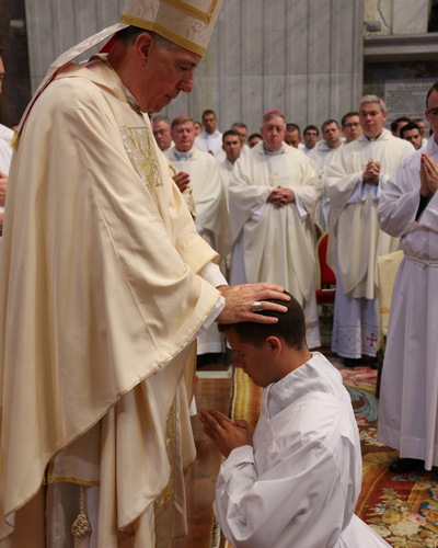 Bishop James Checchio, of Metuchen, N.J., ordains Alan Martineau of Spencer. (Photo courtesy of PNAC Photo Service)