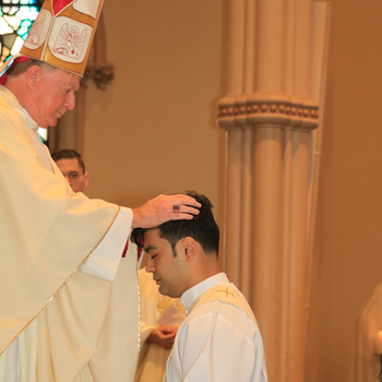 Bishop ordains one priest, two deacons