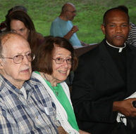 Sturbridge Novena Mass welcome, supports priest