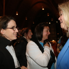 Women hear speakers talk about the Eucharist