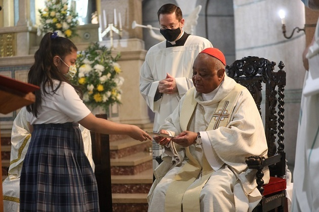 Sacred Heart student gifts handpainted cross to CCA board member Cardinal Wilton Gregory