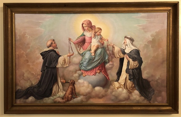 This painting of Our Lady of the Rosary is hung in the dining room of the rectory.