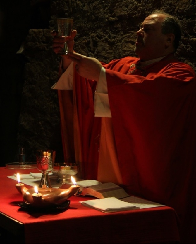 Fr. Buddy Noel celebrating Mass in the Catacombs in Rome in 2015. Photo by Mr. Frank Smode.
