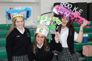 Seniors Receive Decorated Caps from Little Sisters on Senior Hat Day