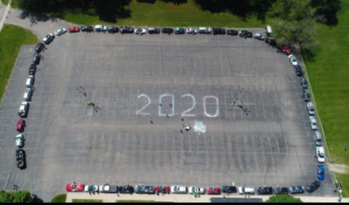 2020 and cars parked for the parade