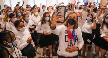 Olympic champion gets hero's welcome at Maryland Catholic school alma mater