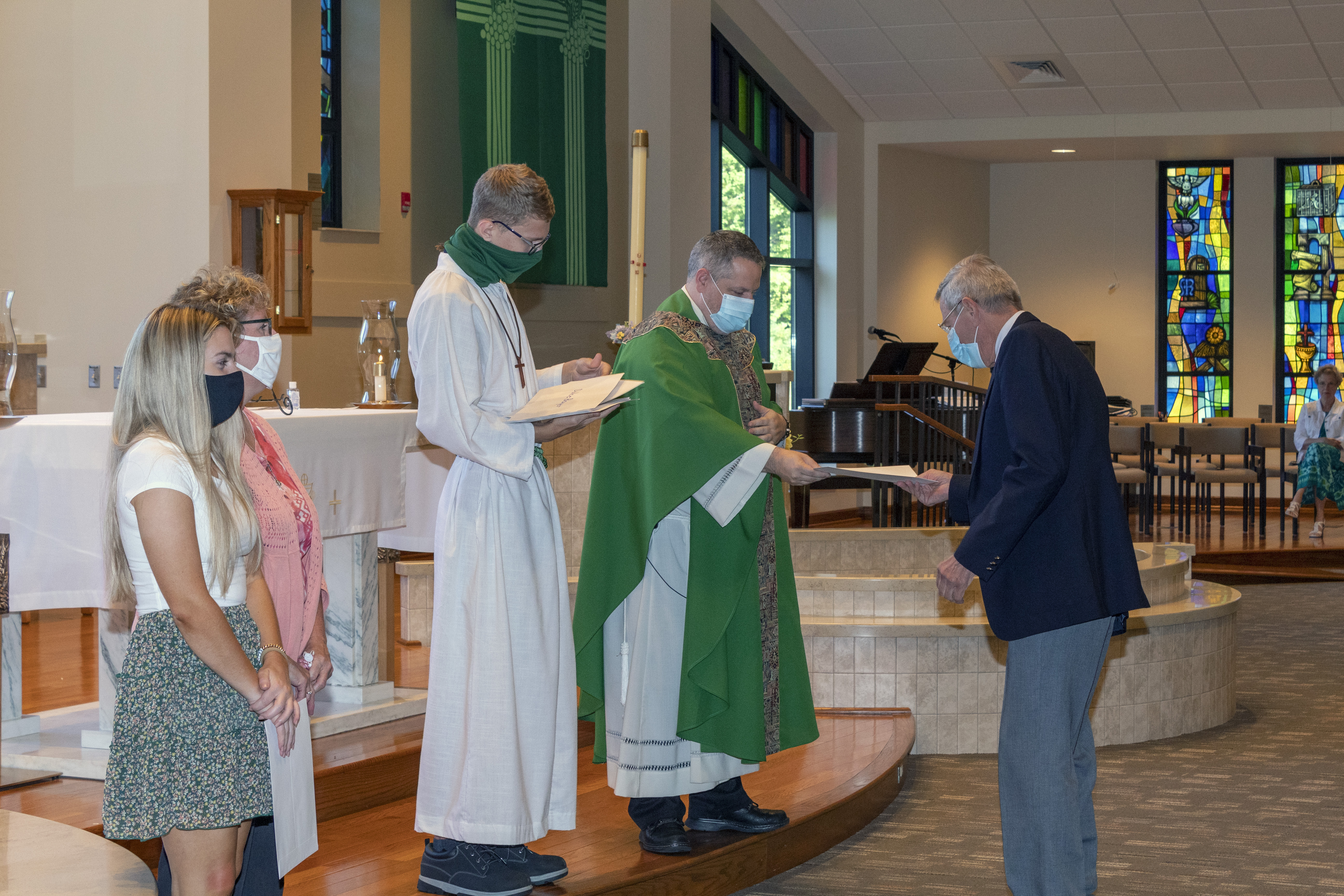 St. Thomas Catechists are commissioned by Father Kopp.
